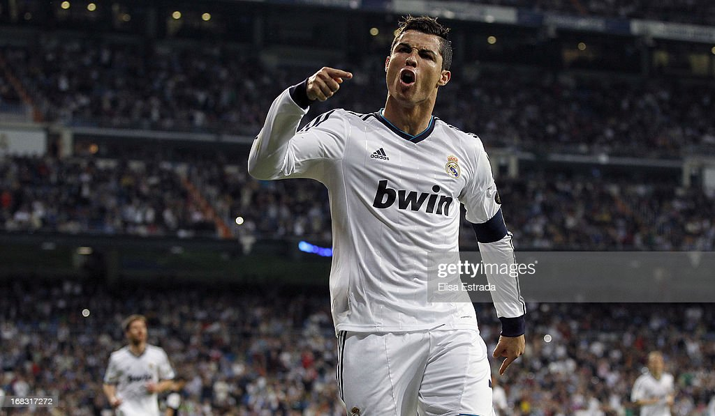 <a gi-track='captionPersonalityLinkClicked' href=/galleries/search?phrase=Cristiano+Ronaldo+-+Soccer+Player&family=editorial&specificpeople=162689 ng-click='$event.stopPropagation()'>Cristiano Ronaldo</a> of Real Madrid celebrates after scoring during the La Liga match between Real Madrid and Malaga at Estadio Santiago Bernabeu on May 8, 2013 in Madrid, Spain.