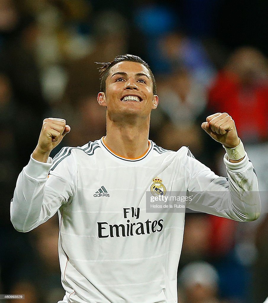 <a gi-track='captionPersonalityLinkClicked' href=/galleries/search?phrase=Cristiano+Ronaldo+-+Soccer+Player&family=editorial&specificpeople=162689 ng-click='$event.stopPropagation()'>Cristiano Ronaldo</a> of Real Madrid celebrates after scoring during the La Liga match between Real Madrid and RC Celta de Vigo at Estadio Santiago Bernabeu on January 6, 2014 in Madrid, Spain.