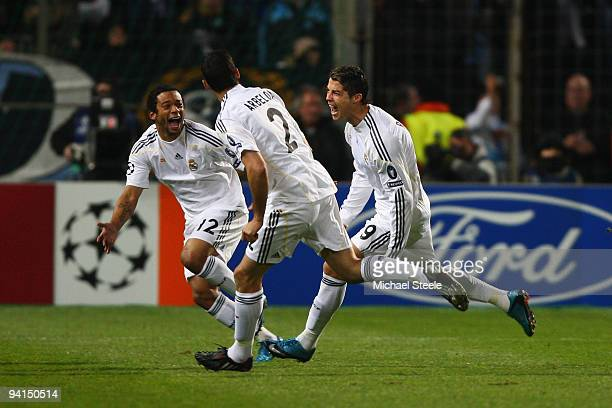 Cristiano Ronaldo of Real Madrid celebrates after scoring from a direct free kick during the Real Madrid UEFA Champions League Group C match between...