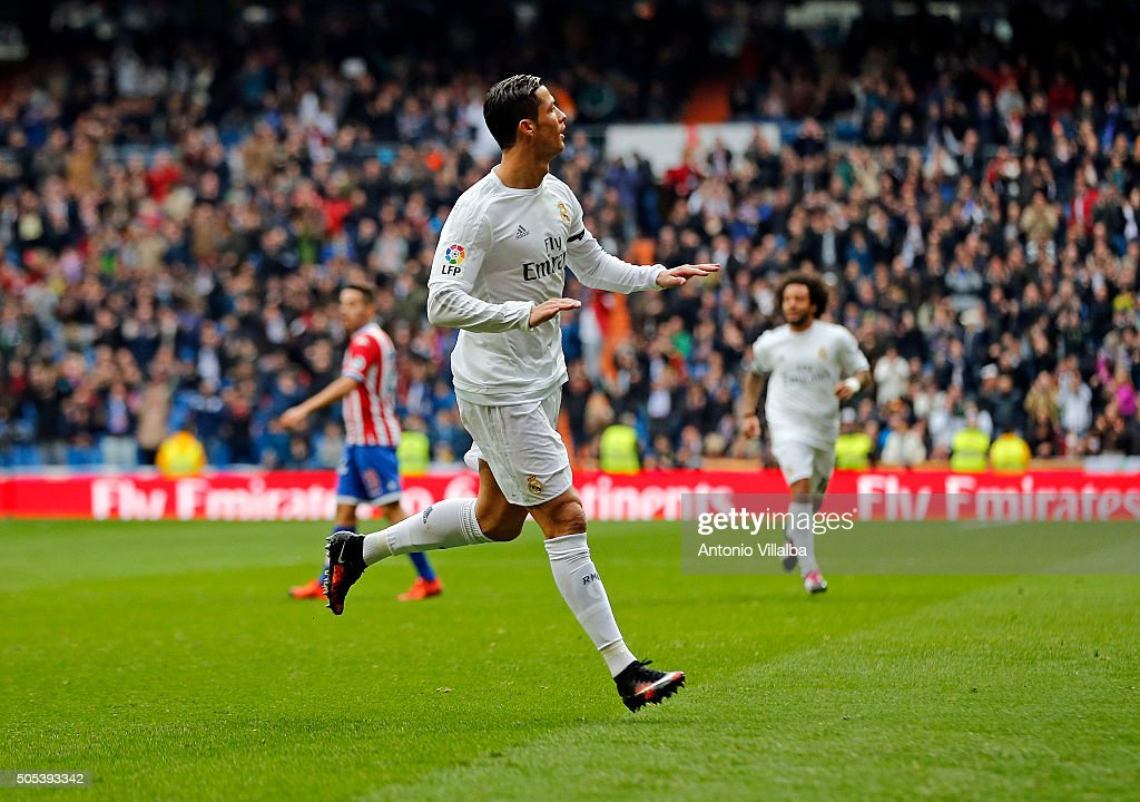 <a gi-track='captionPersonalityLinkClicked' href=/galleries/search?phrase=Cristiano+Ronaldo+-+Soccer+Player&family=editorial&specificpeople=162689 ng-click='$event.stopPropagation()'>Cristiano Ronaldo</a> of Real Madrid celebrates after scoring his first goal during the La Liga match between Real Madrid CF and Sporting de Gijon at Estadio Santiago Bernabeu on January 17, 2016 in Madrid, Spain.