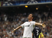 Cristiano Ronaldo of Real Madrid celebrates after scoring his side fourth goal during the UEFA Champions League quarter final first leg match between...