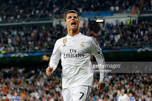 Cristiano Ronaldo of Real Madrid celebrates after scoring his team's second goal during the UEFA Champions League Round of 16 second leg match...
