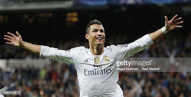 Cristiano Ronaldo of Real Madrid celebrates after scoring his team's fourth goal during the UEFA Champions League Group A match between Real Madrid...