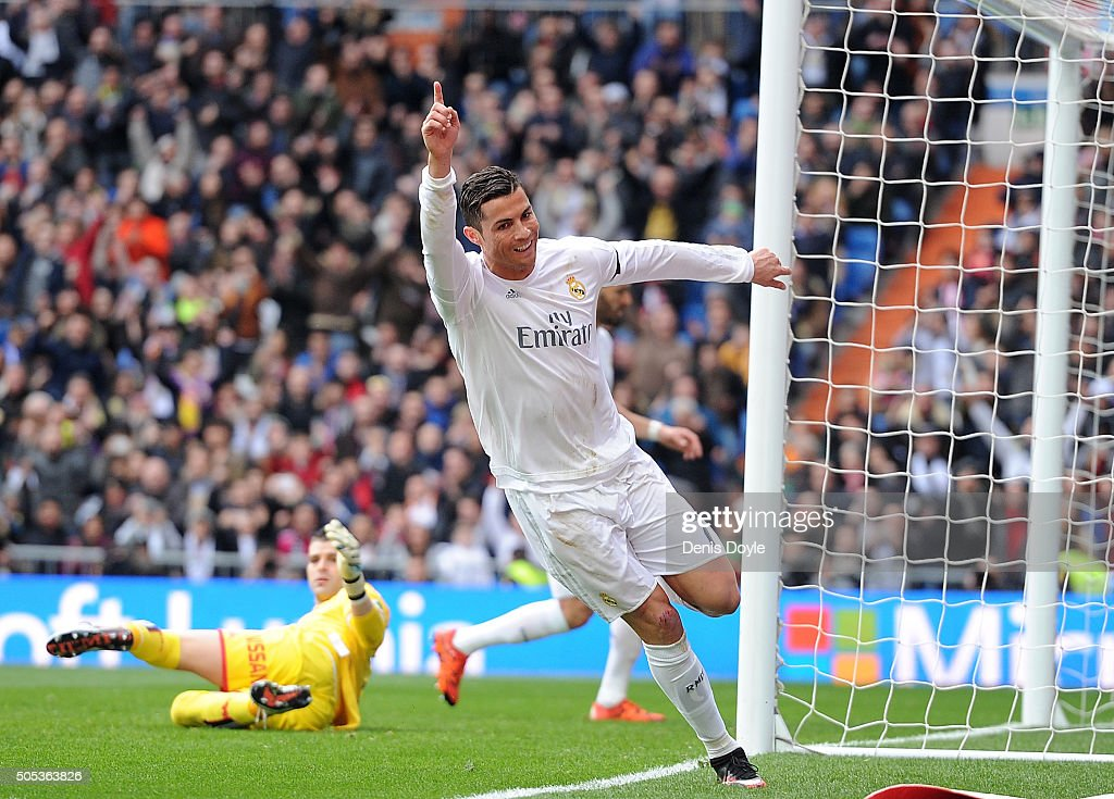 Cristiano Ronaldo of Real Madrid celebrates after scoring his team's 4th goal during the La Liga match between Real Madrid CF and Sporting Gijon at Estadio Santiago Bernabeu on January 17, 2016 in Madrid, Spain.