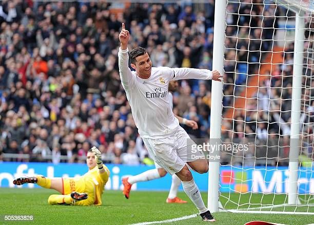 Cristiano Ronaldo of Real Madrid celebrates after scoring his team's 4th goal during the La Liga match between Real Madrid CF and Sporting Gijon at...