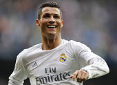 Cristiano Ronaldo of Real Madrid celebrates after scoring his team's fourth goal during the La Liga match between Real Madrid CF and Athletic Club at...