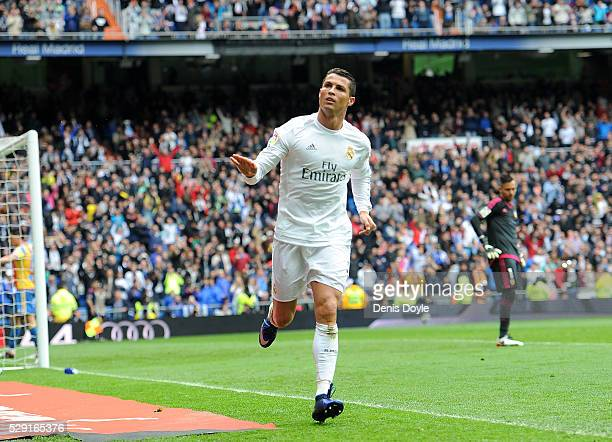 Cristiano Ronaldo of Real Madrid celebrates after scoring his team's 3rd goal during the La Liga match between Real Madrid CF and Valencia CF at...