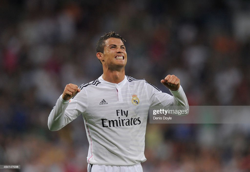 <a gi-track='captionPersonalityLinkClicked' href=/galleries/search?phrase=Cristiano+Ronaldo&family=editorial&specificpeople=162689 ng-click='$event.stopPropagation()'>Cristiano Ronaldo</a> of Real Madrid celebrates after scoring Real's 2nd goal during the La liga match between Real Madrid CF and Cordoba CF at Estadio Santiago Bernabeu on August 25, 2014 in Madrid, Spain.