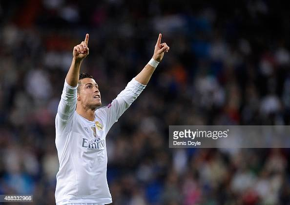 Cristiano Ronaldo of Real Madrid celebrates after scoring Real's 3rd goal from the penalty spot during the UEFA Champions League Group A match...