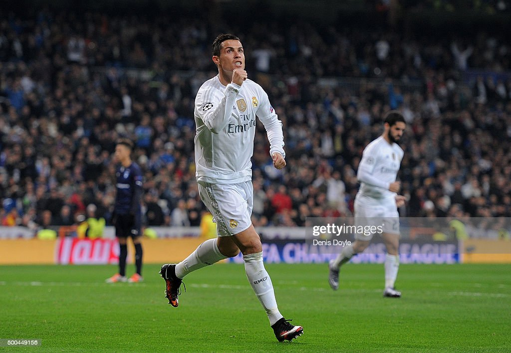 Cristiano Ronaldo of Real Madrid celebrates after scoring Real's 6th goal during the UEFA Champions League Group A match between Real Madrid CF and Malmo FF at the Santiago Bernabeu stadium on December 8, 2015 in Madrid, Spain.