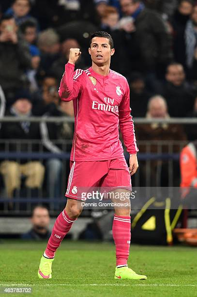Cristiano Ronaldo of Real Madrid celebrates after scoring the opening goal during the UEFA Champions League Round of 16 match between FC Schalke 04...