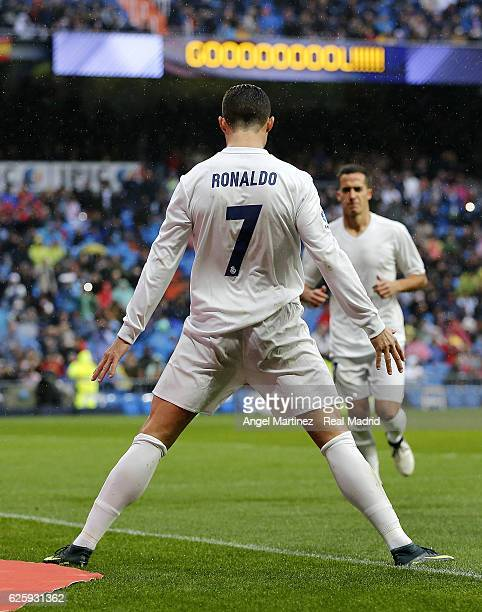 Cristiano Ronaldo of Real Madrid celebrates after scoring the opening goal during the La Liga match between Real Madrid CF and Real Sporting de Gijon...
