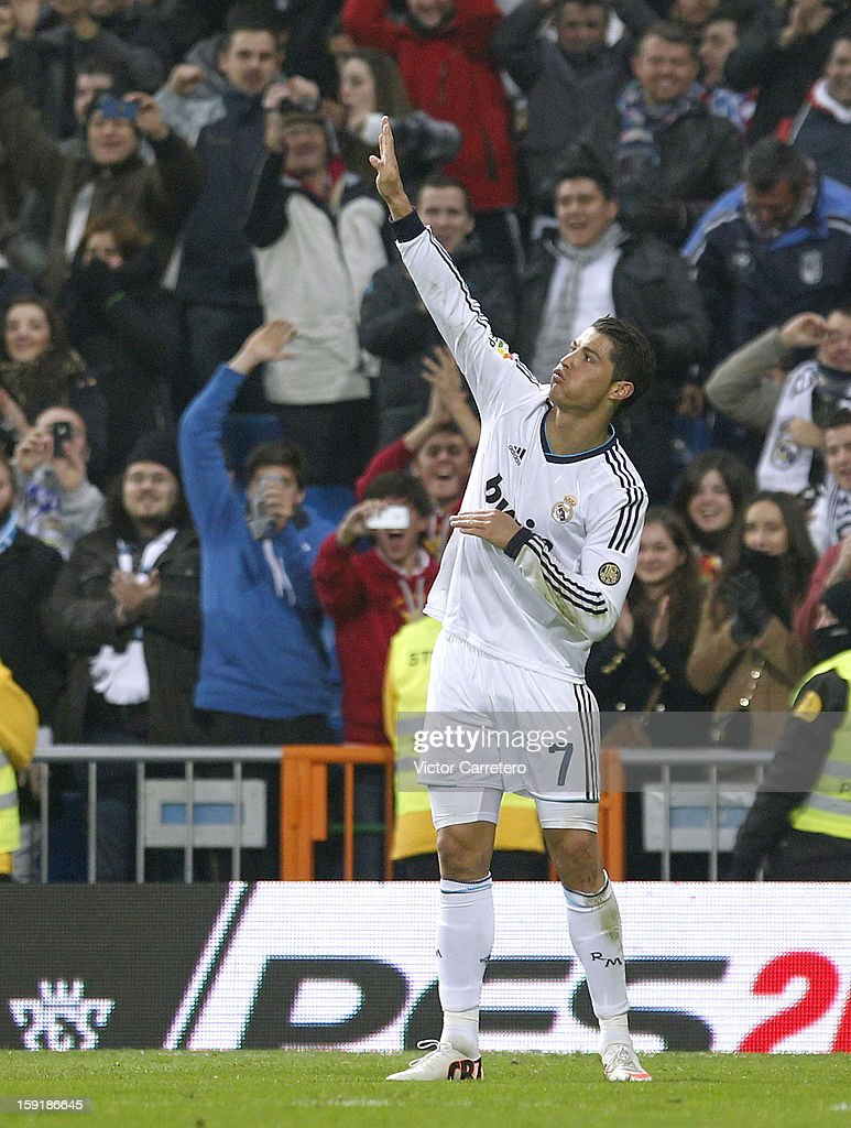 <a gi-track='captionPersonalityLinkClicked' href=/galleries/search?phrase=Cristiano+Ronaldo&family=editorial&specificpeople=162689 ng-click='$event.stopPropagation()'>Cristiano Ronaldo</a> of Real Madrid celebrates after scoring their third goal and completing his hat-trick during the Copa del Rey round of 16 second leg match between Real Madrid and Celta de Vigo at Estadio Santiago Bernabeu on January 9, 2013 in Madrid, Spain.