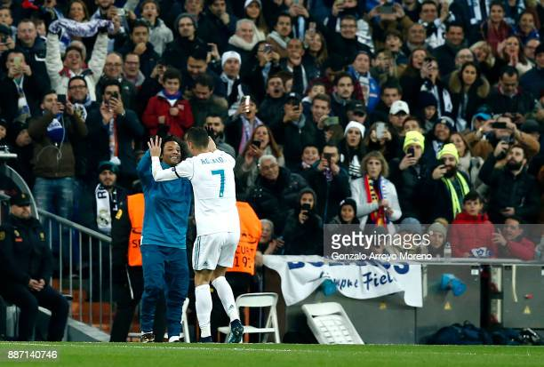Cristiano Ronaldo of Real Madrid celebrates after soring his sides second goal with Marcelo of Real Madrid during the UEFA Champions League group H...