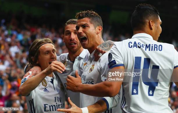 Cristiano Ronaldo of Real Madrid celebrates as he scores their first goal with team mates during the UEFA Champions League semi final first leg match...
