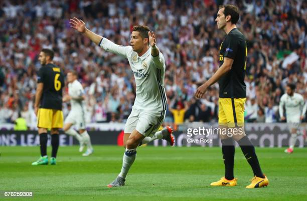 Cristiano Ronaldo of Real Madrid celebrates as he scores their first goal during the UEFA Champions League semi final first leg match between Real...