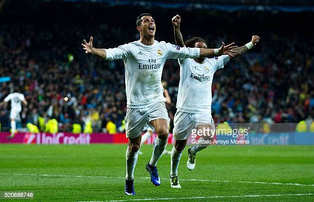 Cristiano Ronaldo of Real Madrid celebrates as he scores their third goal from a free kick and completes his hat trick during the UEFA Champions...