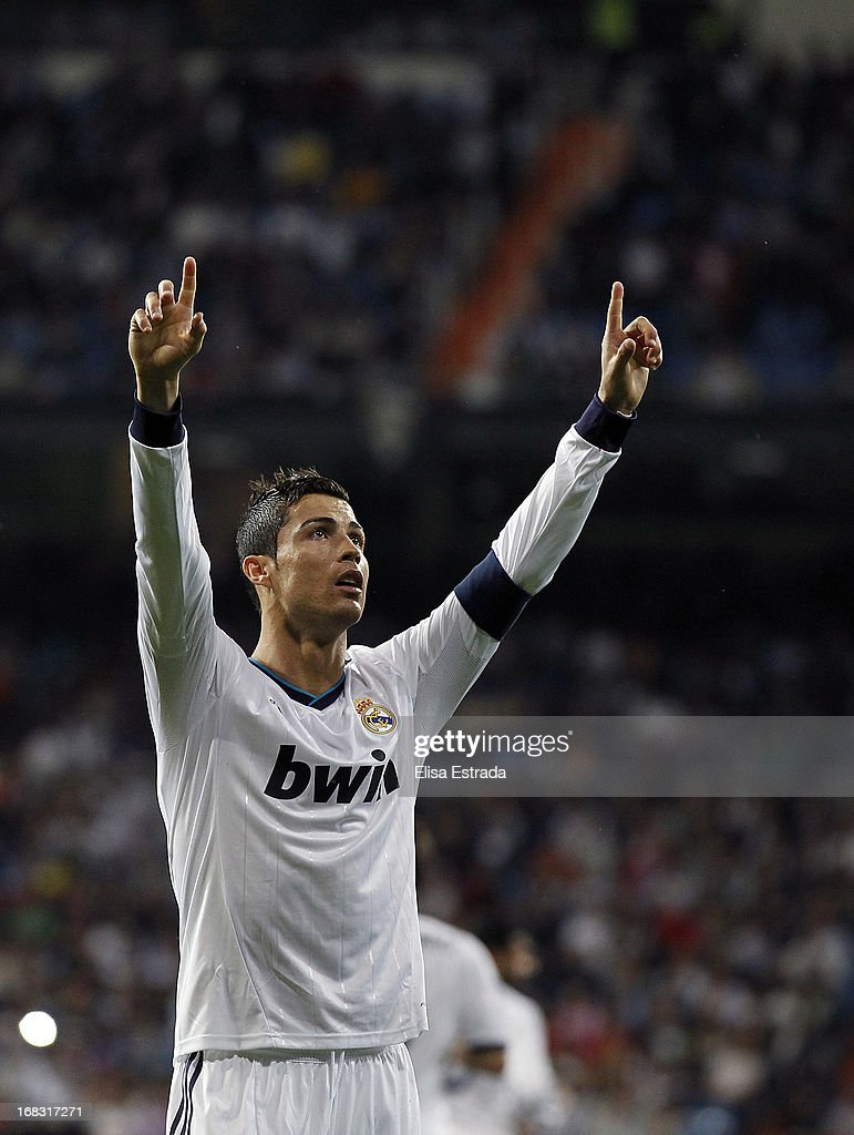 <a gi-track='captionPersonalityLinkClicked' href=/galleries/search?phrase=Cristiano+Ronaldo+-+Soccer+Player&family=editorial&specificpeople=162689 ng-click='$event.stopPropagation()'>Cristiano Ronaldo</a> of Real Madrid celebrates during the La Liga match between Real Madrid and Malaga at Estadio Santiago Bernabeu on May 8, 2013 in Madrid, Spain.