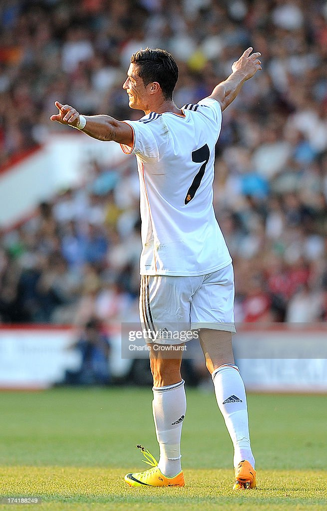 <a gi-track='captionPersonalityLinkClicked' href=/galleries/search?phrase=Cristiano+Ronaldo&family=editorial&specificpeople=162689 ng-click='$event.stopPropagation()'>Cristiano Ronaldo</a> of Real Madrid celebrates his first goal during the pre season friendly match between Bournemouth and Real Madrid at Goldsands Stadium on July 21, 2013 in Bournemouth, England,