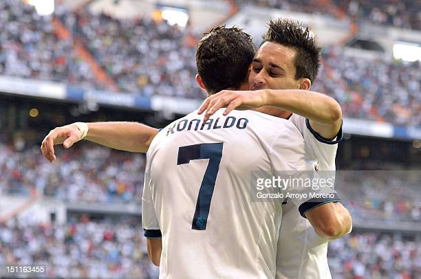 Cristiano Ronaldo of Real Madrid celebrates his first goal with Jose Maria Callejon during the La Liga match between Real Madrid and Granada at...