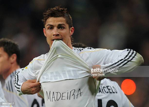 Cristiano Ronaldo of Real Madrid celebrates his goal wearing a tshirt with the name of the Portuguese island of Madeira in memory of the recent...