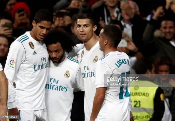 Cristiano Ronaldo of Real Madrid celebrates his goal with teammates Raphael Varane Lucas Vazquez and Marcelo Vieira during the La Liga match between...