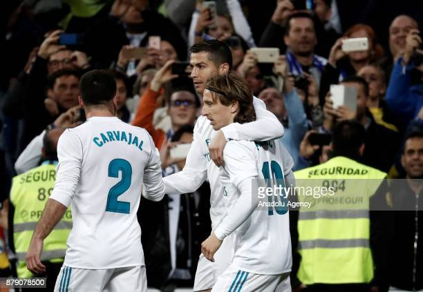 Cristiano Ronaldo of Real Madrid celebrates his goal with teammates Daniel Carvajal and Luka Modric during the La Liga match between Real Madrid and...