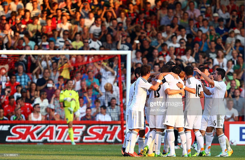 Cristiano Ronaldo of Real Madrid celebrates his opening goal with team mates during a pre season friendly match between AFC Bournemouth and Real Madrid at Goldsands Stadium on July 21, 2013 in Bournemouth, England.