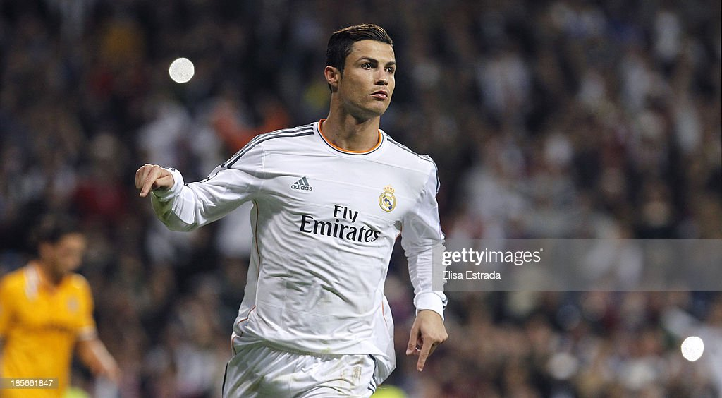 <a gi-track='captionPersonalityLinkClicked' href=/galleries/search?phrase=Cristiano+Ronaldo+-+Soccer+Player&family=editorial&specificpeople=162689 ng-click='$event.stopPropagation()'>Cristiano Ronaldo</a> of Real Madrid celebrates his second goal during the UEFA Champions League Group B match between Real Madrid and Juventus at Estadio Santiago Bernabeu on October 23, 2013 in Madrid, Spain.