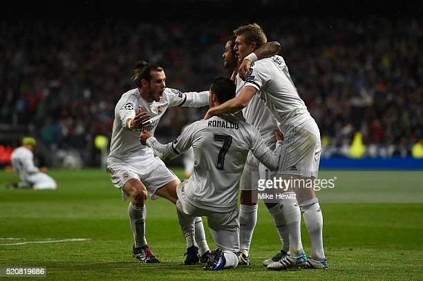 Cristiano Ronaldo of Real Madrid celebrates his second goal with Gareth Bale Marcelo and Toni Kroos during the UEFA Champions League quarter final...