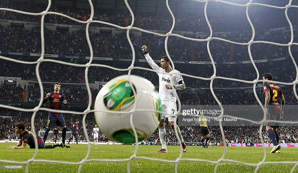 <a gi-track='captionPersonalityLinkClicked' href=/galleries/search?phrase=Cristiano+Ronaldo+-+Soccer+Player&family=editorial&specificpeople=162689 ng-click='$event.stopPropagation()'>Cristiano Ronaldo</a> of Real Madrid celebrates his team's equalizing goal during the Copa del Rey Semi-Final first leg match between Real Madrid CF and FC Barcelona at Estadio Santiago Bernabeu on January 30, 2013 in Madrid, Spain.