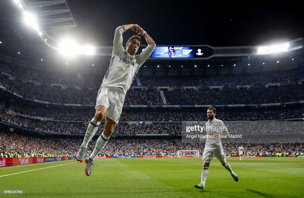 Cristiano Ronaldo (L) of Real Madrid celebrates his team's second goal during the UEFA Champions League Semi Final first leg match between Real Madrid CF and Club Atletico de Madrid at Estadio Santiago Bernabeu on May 2, 2017 in Madrid, Spain.