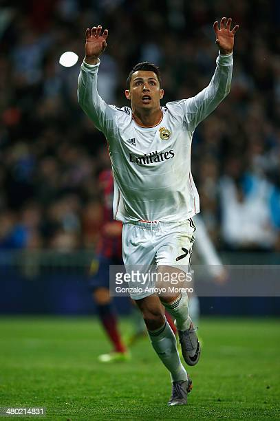 Cristiano Ronaldo of Real Madrid celebrates his team's third goal during the La Liga match between Real Madrid CF and FC Barcelona at the Bernabeu on...