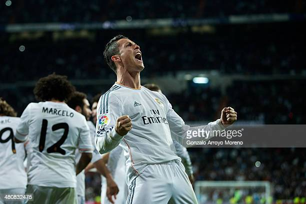 Cristiano Ronaldo of Real Madrid celebrates his team's third goal during the La Liga match between Real Madrid CF and FC Barcelona at Estadio...
