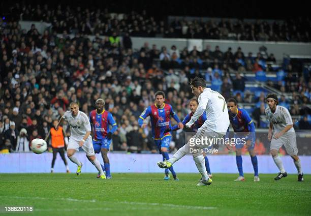 Cristiano Ronaldo of Real Madrid celebrates scores Real's opening goal from the penalty spot during the La Liga match between Real Madrid and Levante...
