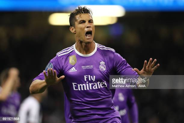 Cristiano Ronaldo of Real Madrid celebrates scoring a goal to make the score 01 during the UEFA Champions League Final between Juventus and Real...
