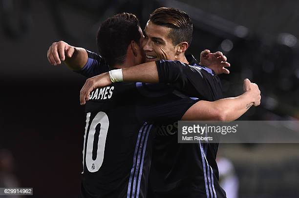 Cristiano Ronaldo of Real Madrid celebrates scoring a goal with James Rodriguez during the FIFA Club World Cup Japan semifinal match between Club...