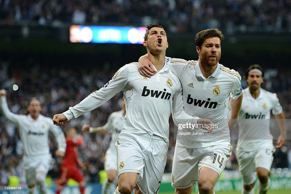 Cristiano Ronaldo of Real Madrid celebrates scoring from the penalty spot with Xabi Alonso of Real Madrid during the UEFA Champions League Semi Final...