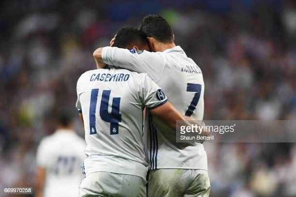 Cristiano Ronaldo of Real Madrid celebrates scoring his sides first goal with Casemiro of Real Madrid during the UEFA Champions League Quarter Final...
