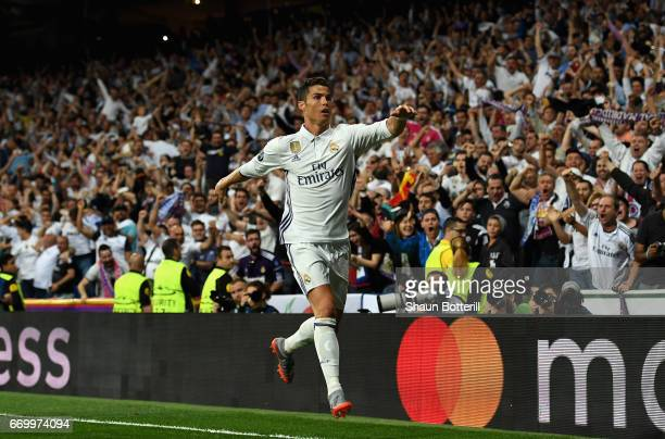 Cristiano Ronaldo of Real Madrid celebrates scoring his sides first goal during the UEFA Champions League Quarter Final second leg match between Real...