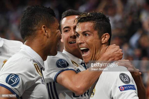 Cristiano Ronaldo of Real Madrid celebrates scoring his sides first goal with his Real Madrid team mates during the UEFA Champions League Quarter...