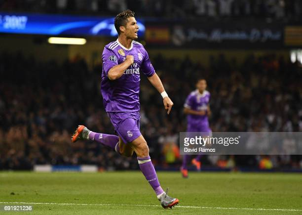 Cristiano Ronaldo of Real Madrid celebrates scoring his sides first goal during the UEFA Champions League Final between Juventus and Real Madrid at...