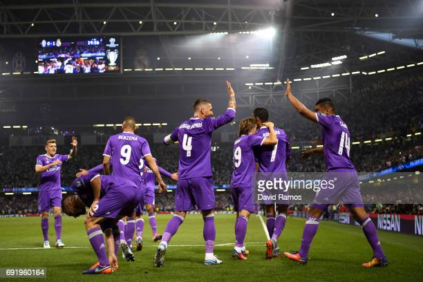 Cristiano Ronaldo of Real Madrid celebrates scoring his sides first goal with teammates during the UEFA Champions League Final between Juventus and...