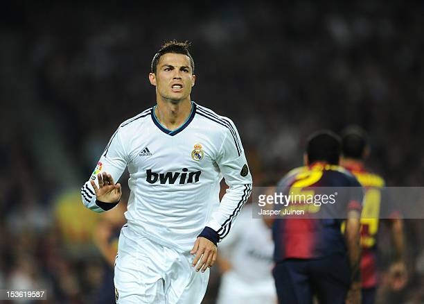 Cristiano Ronaldo of Real Madrid celebrates scoring his sides opening goal during the la Liga match between FC Barcelona and Real Madrid at the Camp...