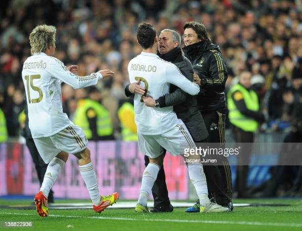 Cristiano Ronaldo of Real Madrid celebrates scoring his sides second goial with head coach Jose Mourinho as Fabio Coentrao joins in during the la...