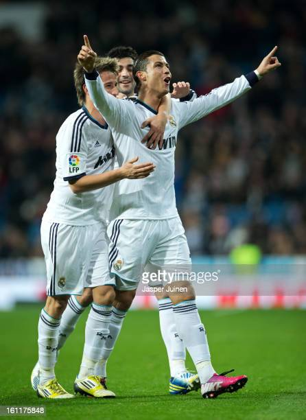 Cristiano Ronaldo of Real Madrid celebrates scoring his sides second goal with his teammates Fabio Coentrao and Raul Albiol during the la Liga match...