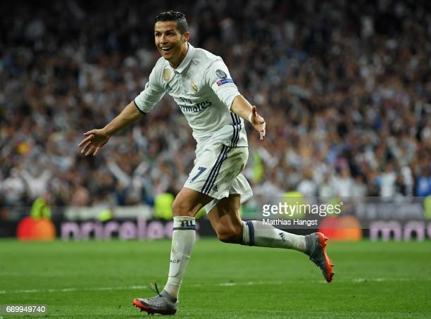 Cristiano Ronaldo of Real Madrid celebrates scoring his sides second goal during the UEFA Champions League Quarter Final second leg match between...