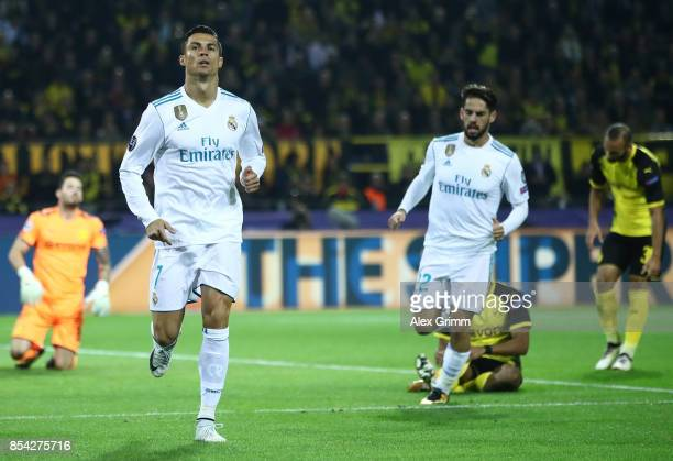 Cristiano Ronaldo of Real Madrid celebrates scoring his sides second goal with his Real Madrid team mates during the UEFA Champions League group H...