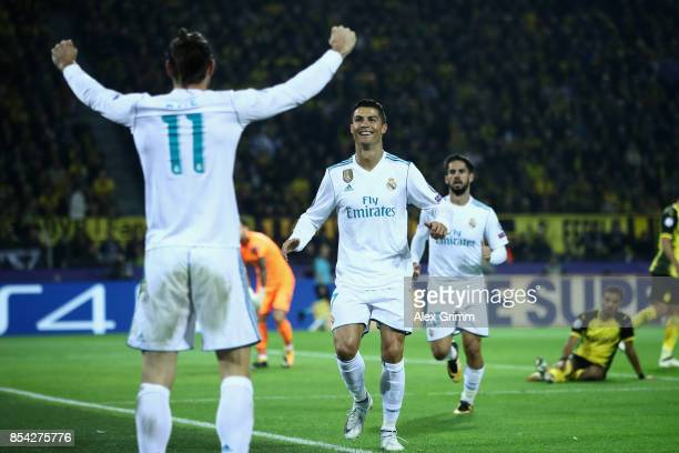 Cristiano Ronaldo of Real Madrid celebrates scoring his sides second goal with Gareth Bale of Real Madrid during the UEFA Champions League group H...