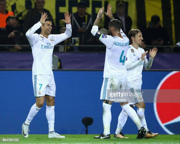 Cristiano Ronaldo of Real Madrid celebrates scoring his sides third goal with Sergio Ramos of Real Madrid during the UEFA Champions League group H...